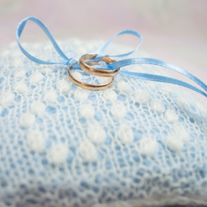 White ring cushion with Greta Garbo Pattern and light blue pillow by Artanis Wedding Lace
